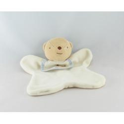 Doudou plat ours blanc bavoir DMC