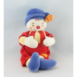 Doudou Clown salopette rouge chapeau bleu fleur Sucre d'Orge
