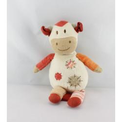 Doudou musical vache blanc beige orange NATURE ET DECOUVERTE