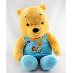 Grande peluche Winnie l'ourson pyjama grenouillére bleu Disney