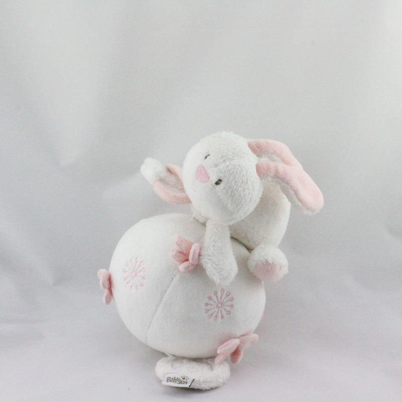 Doudou musical lapin blanc rose sur balle BABYSUN