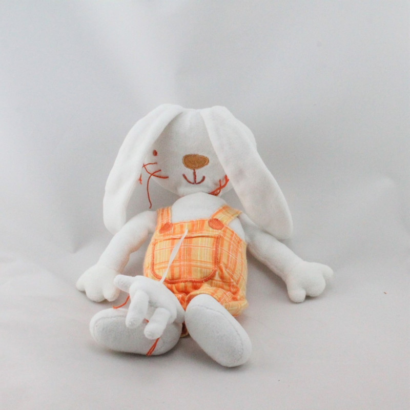 Doudou lapin blanc salopette orange TAPE A L'OEIL