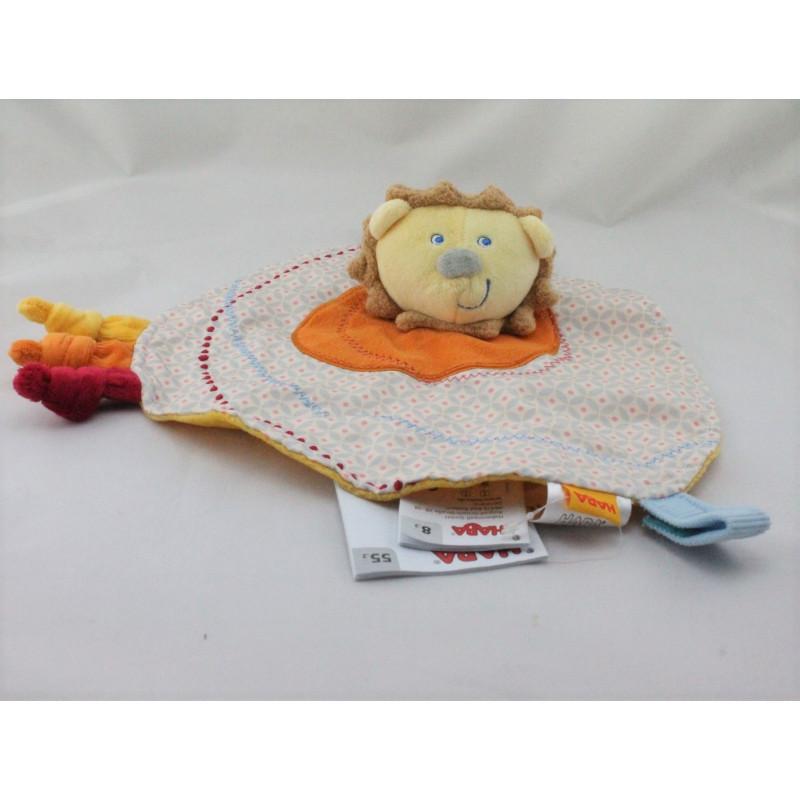 Doudou plat rond lion jaune orange bleu HABA