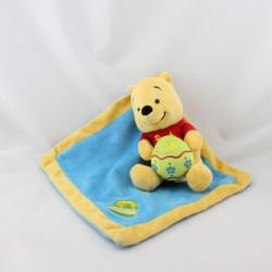 Doudou Winnie l'Ourson avec mouchoir bleu miel Disney Gipsy