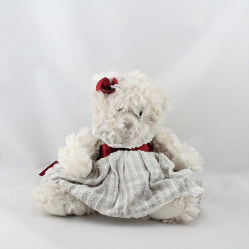 Peluche ours robe beige noeud rouge BUKOWSKI