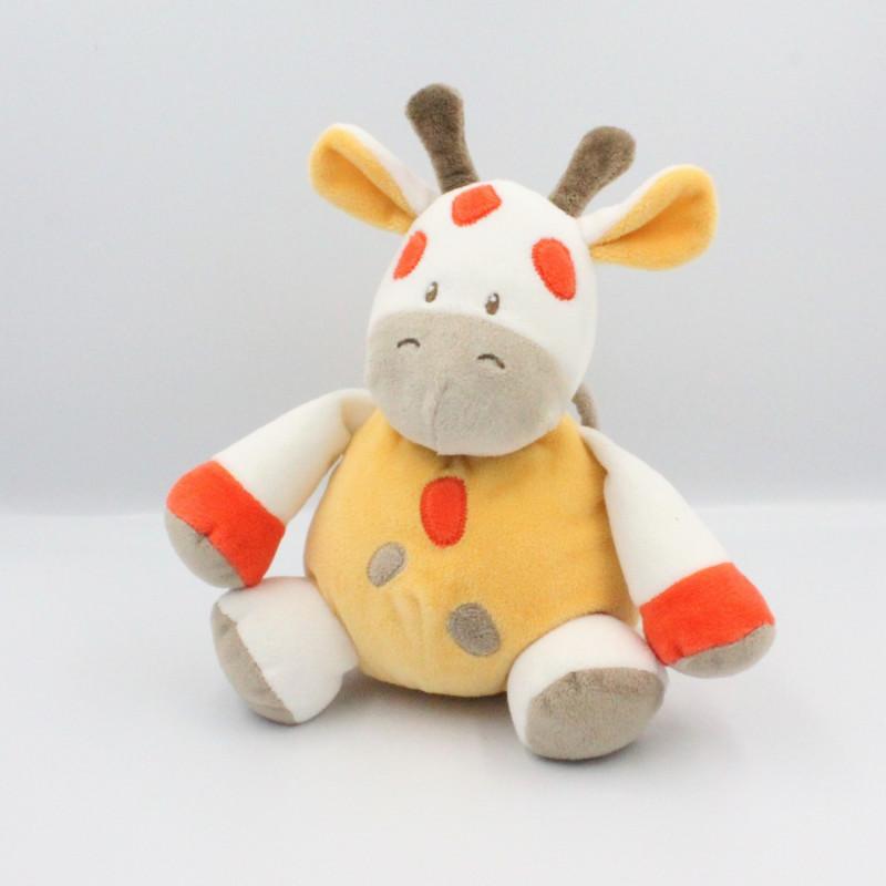Doudou musical girafe vache blanc beige jaune orange DOUKIDOU