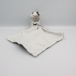 Doudou vache blanche noir beige mouchoir Obaibi