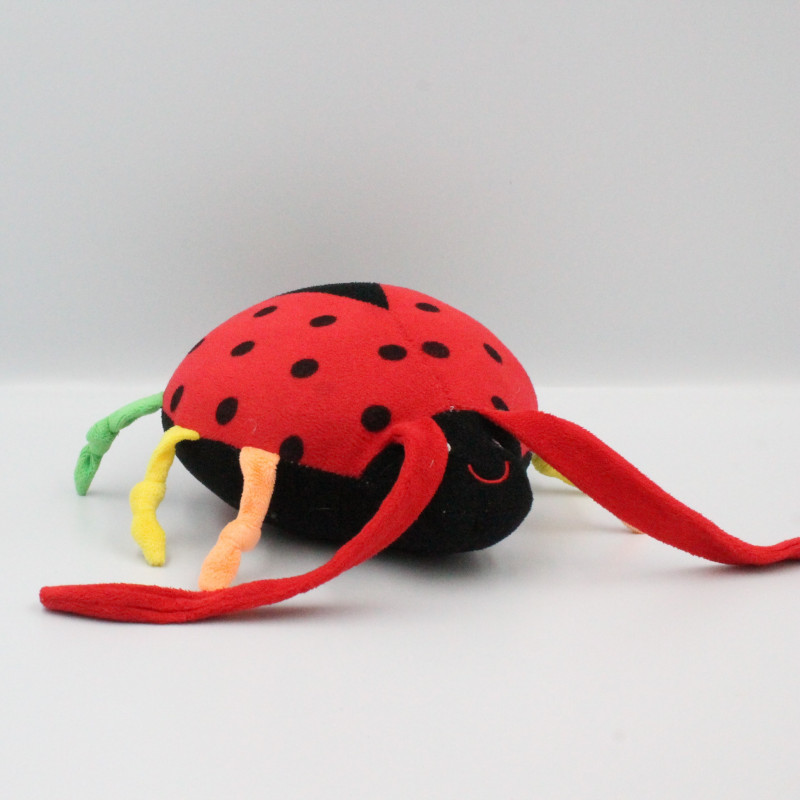 Doudou musical coccinelle rouge noir vert jaune orange