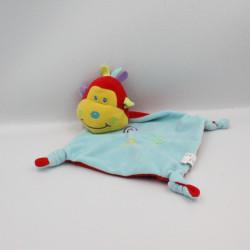 Doudou plat singe rouge bleu jaune GMBH