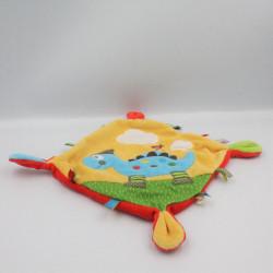Doudou plat dinosaure bleu jaune rouge vert NICOTOY