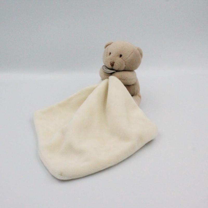 Doudou et compagnie Ours beige avec mouchoir blanc