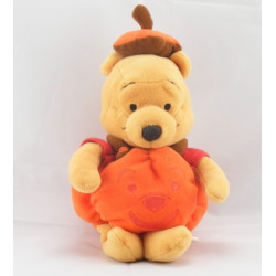 Peluche Winnie sorciére sur son balai Halloween Collection Disney