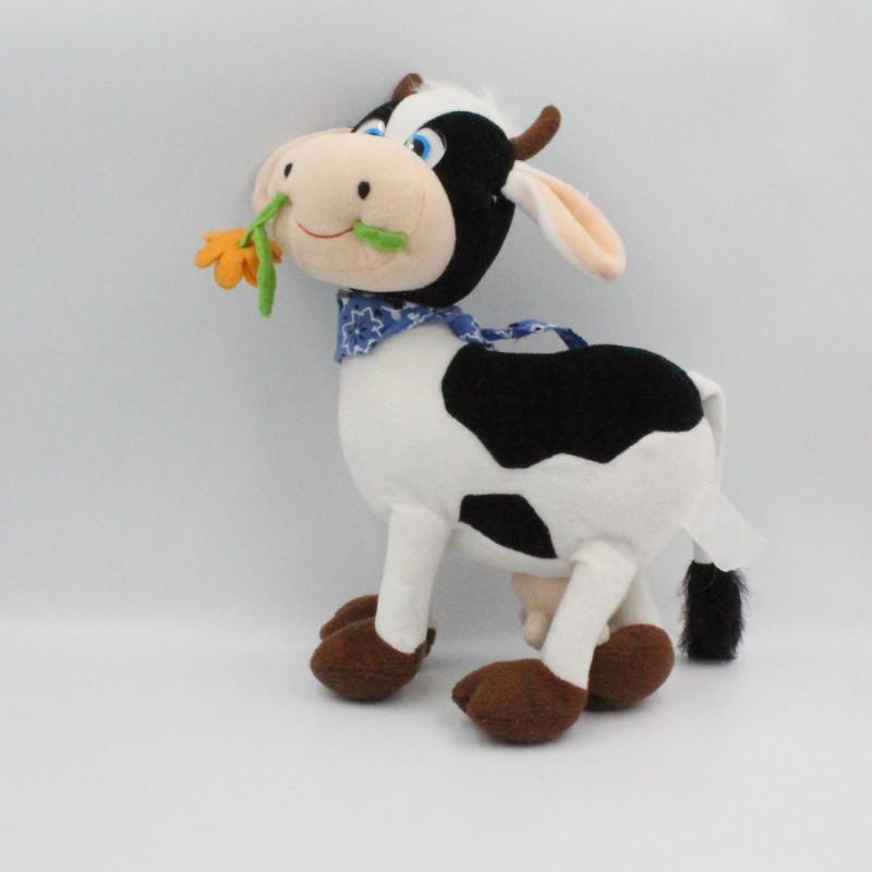 Peluche vache blanche et noir avec fleur