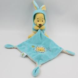 Doudou Winnie l'ourson déguisé en lapin bleu mouchoir DISNEY