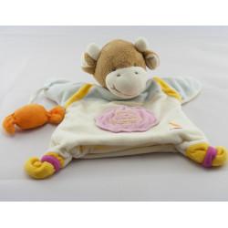 Doudou et compagnie marionnette vache blanc rose bonbons