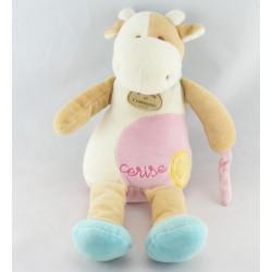 Doudou et compagnie vache Cerise avec bonbon