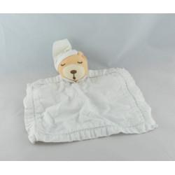 Doudou plat rond blanc ours dragée KALOO